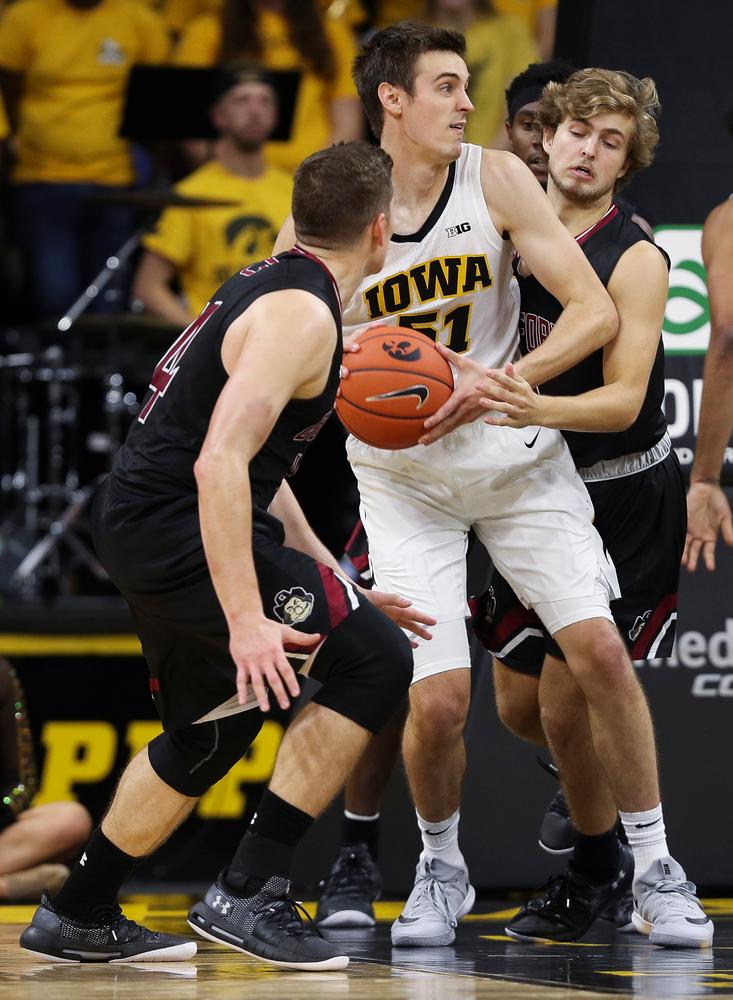 Iowa Hawkeyes forward Nicholas Baer (51) pulls down a rebound during a game against Guilford College at Carver-Hawkeye Arena on November 4, 2018. (Tork Mason/hawkeyesports.com)