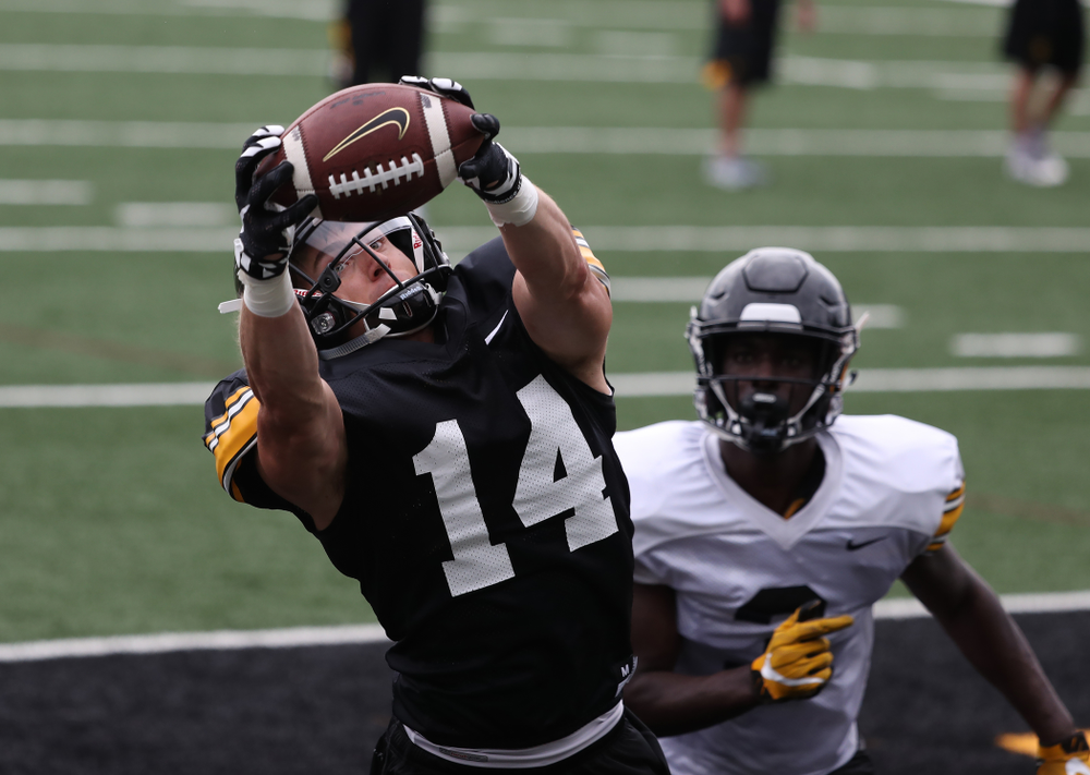 Iowa Hawkeyes wide receiver Kyle Groeneweg (14) and defensive back Trey Creamer (3) during practice No. 4 of Fall Camp Monday, August 6, 2018 at the Hansen Football Performance Center. (Brian Ray/hawkeyesports.com)