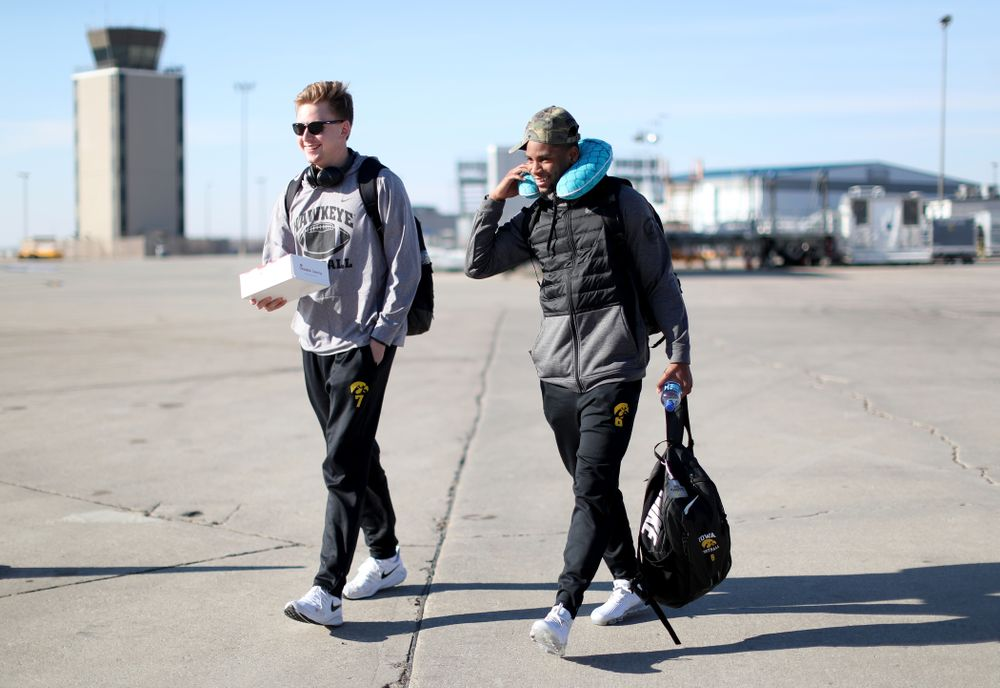 Iowa Hawkeyes quarterback Spencer Petras (7) and wide receiver Ihmir Smith-Marsette (6) board the team plane at the Eastern Iowa Airport Saturday, December 21, 2019 on the way to San Diego, CA for the Holiday Bowl. (Brian Ray/hawkeyesports.com)