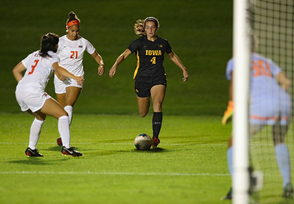 Iowa forward Kaleigh Haus (4) moves with the ball during the second half of their match against Illinois at the Iowa Soccer Complex in Iowa City on Thursday, Sep 26, 2019. (Stephen Mally/hawkeyesports.com)