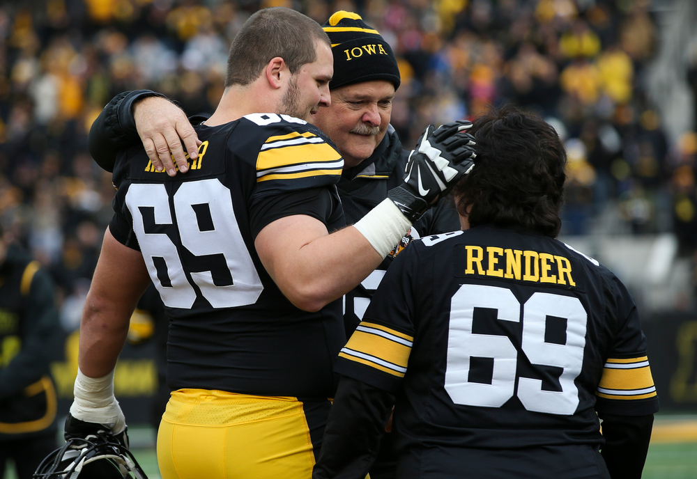 Iowa Hawkeyes offensive lineman Keegan Render (69) is greeted by his parents during Senior Day ceremonies before a game against Nebraska at Kinnick Stadium on November 23, 2018. (Tork Mason/hawkeyesports.com)