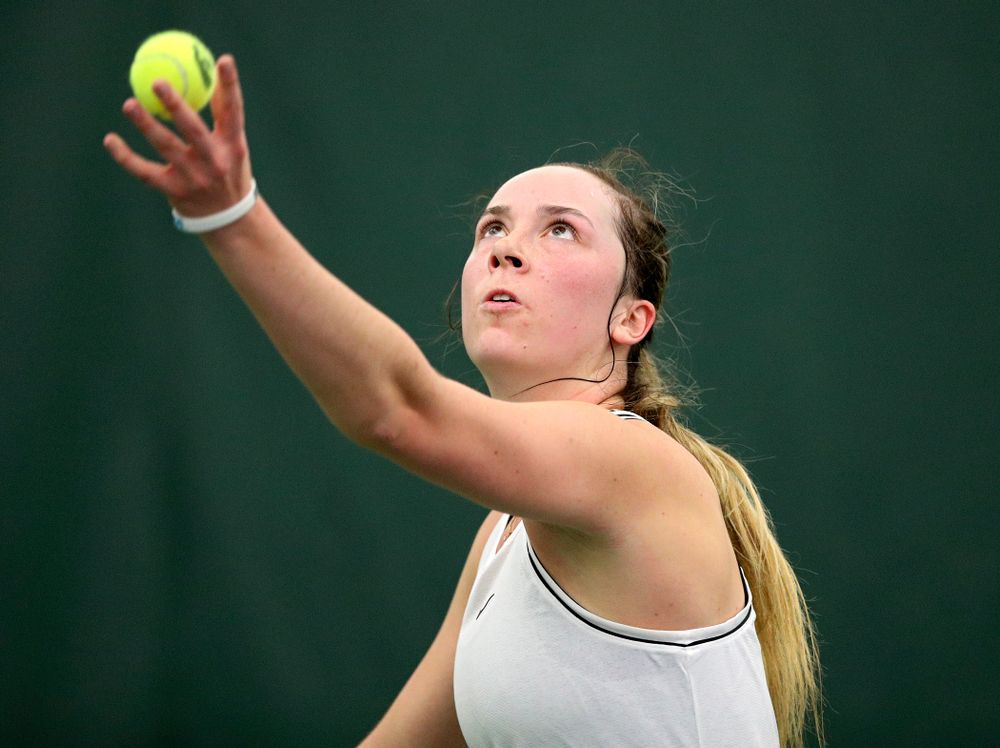 Iowa's Samantha Mannix serves during her singles match at the Hawkeye Tennis and Recreation Complex in Iowa City on Sunday, February 16, 2020. (Stephen Mally/hawkeyesports.com)