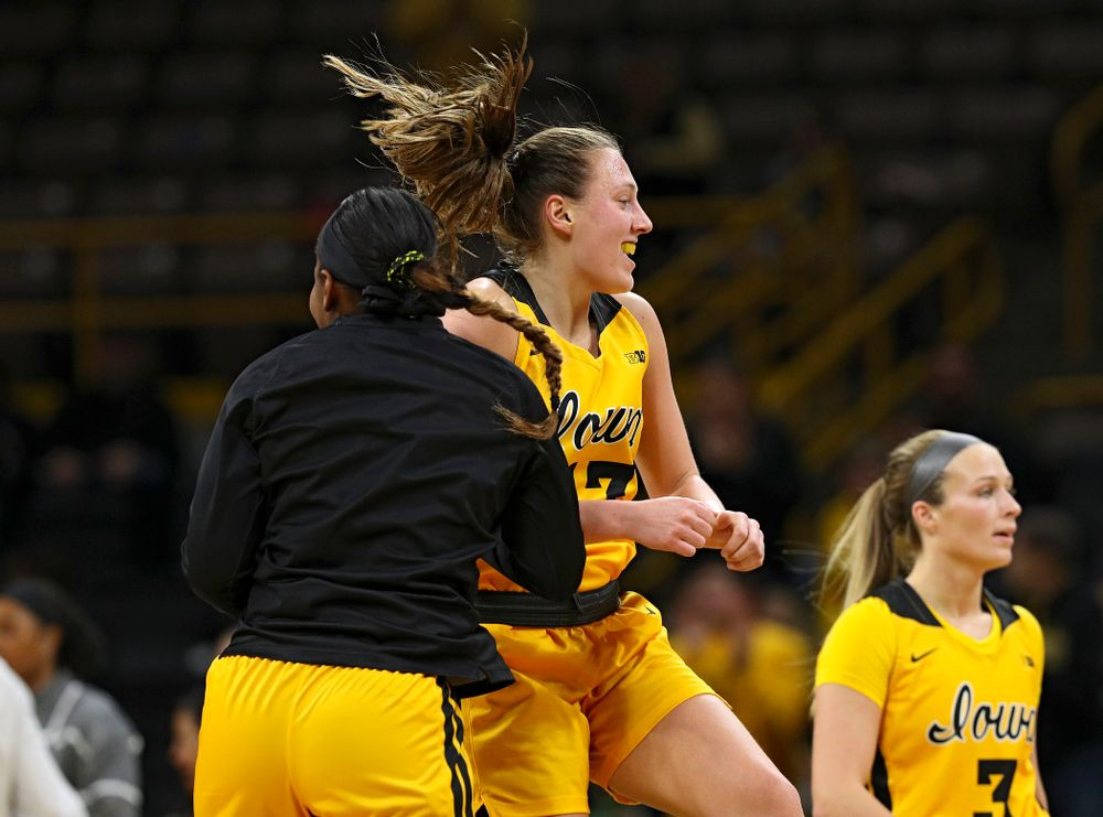 Iowa Hawkeyes forward Amanda Ollinger (43) celebrates with guard Zion Sanders (21) as she makes her way back to the bench during a timeout in the third quarter of their game at Carver-Hawkeye Arena in Iowa City on Thursday, January 23, 2020. (Stephen Mally/hawkeyesports.com)