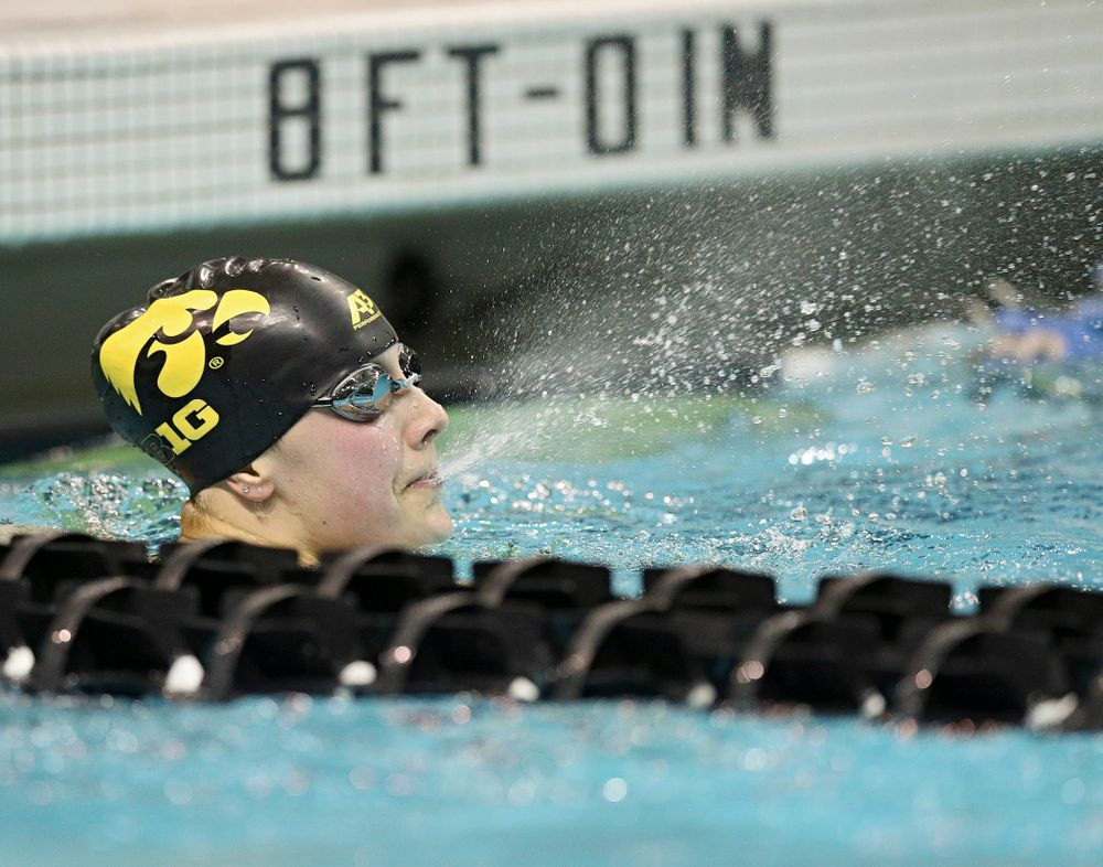 Iowa's Hannah Burvill blows water out of her mouth after swimming the women's 100 yard freestyle consolation final event during the 2020 Women's Big Ten Swimming and Diving Championships at the Campus Recreation and Wellness Center in Iowa City on Saturday, February 22, 2020. (Stephen Mally/hawkeyesports.com)