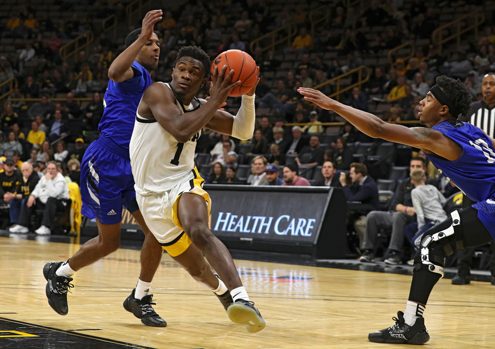 Iowa Hawkeyes guard Joe Toussaint (1) drives between two defenders during the first half of their exhibition game against Lindsey Wilson College at Carver-Hawkeye Arena in Iowa City on Monday, Nov 4, 2019. (Stephen Mally/hawkeyesports.com)