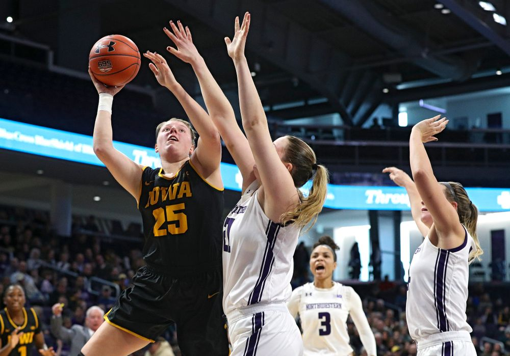 Iowa Hawkeyes forward Monika Czinano (25) shoots during the second quarter of their game at Welsh-Ryan Arena in Evanston, Ill. on Sunday, January 5, 2020. (Stephen Mally/hawkeyesports.com)
