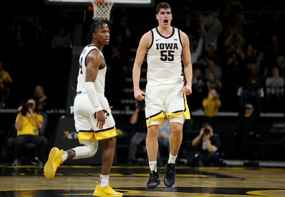 Iowa Hawkeyes forward Luka Garza (55) celebrates a three point basket against the Maryland Terrapins Friday, January 10, 2020 at Carver-Hawkeye Arena. (Brian Ray/hawkeyesports.com)