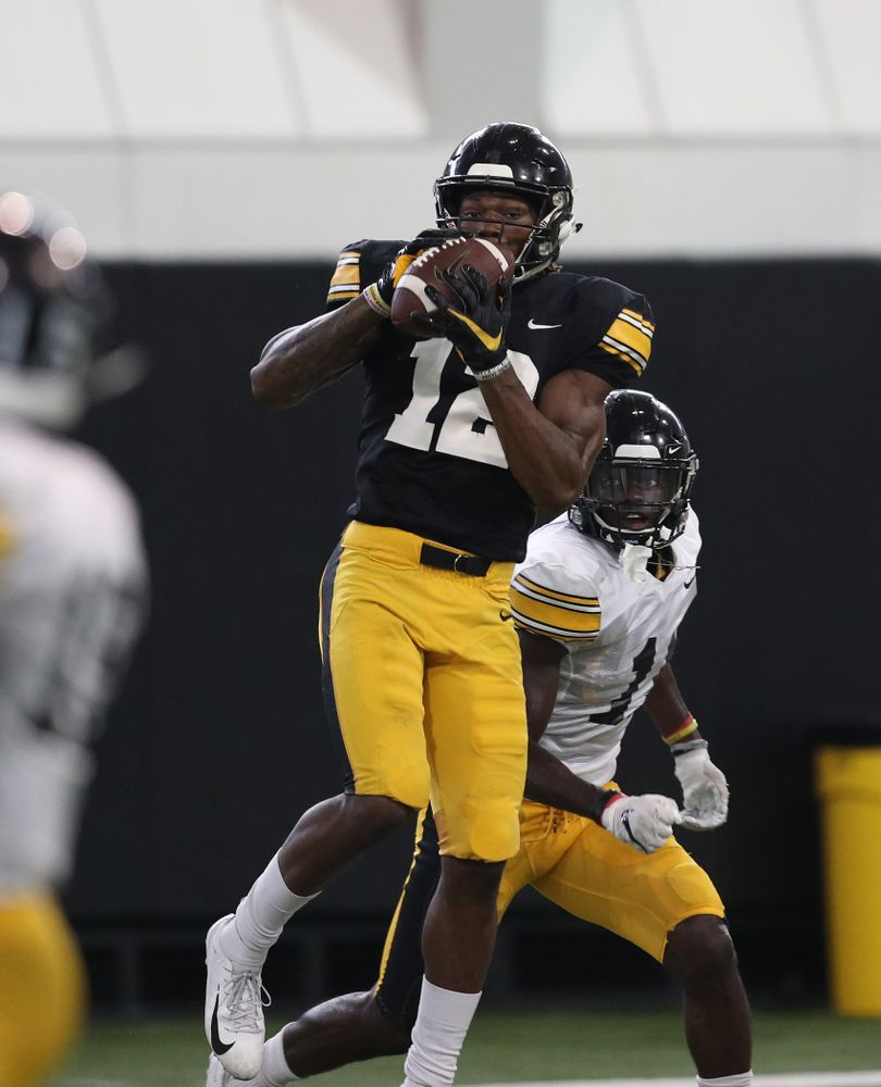 Iowa Hawkeyes wide receiver Brandon Smith (12) and defensive back Michael Ojemudia (11) During Fall Camp Practice No. 6 Thursday, August 8, 2019 at the Ronald D. and Margaret L. Kenyon Football Practice Facility. (Brian Ray/hawkeyesports.com)