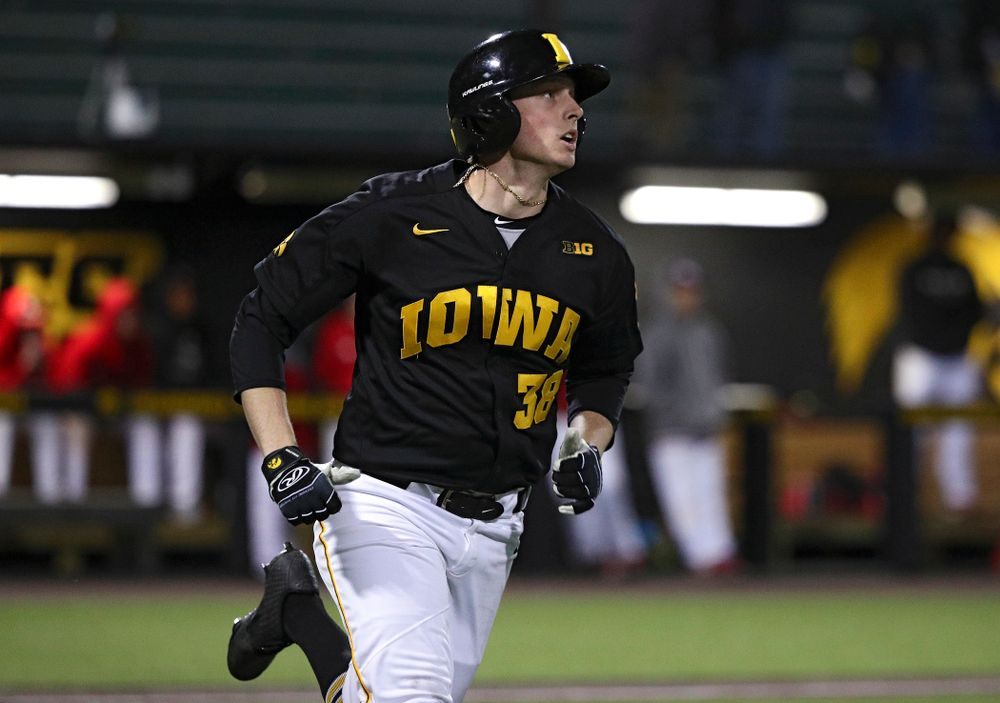 Iowa designated hitter Trenton Wallace (38) hits a home run during the eighth inning of their game at Duane Banks Field in Iowa City on Tuesday, March 3, 2020. (Stephen Mally/hawkeyesports.com)