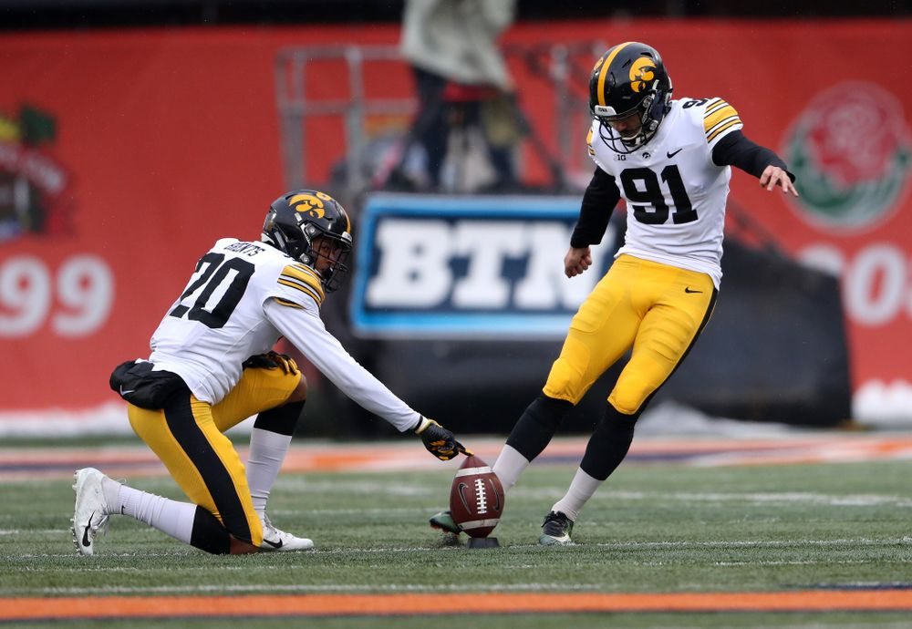 Iowa Hawkeyes place kicker Miguel Recinos (91) and defensive back Julius Brents (20) against the Illinois Fighting Illini Saturday, November 17, 2018 at Memorial Stadium in Champaign, Ill. (Brian Ray/hawkeyesports.com)