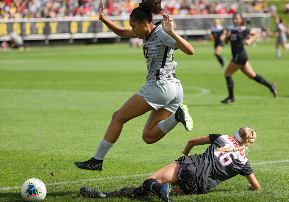Iowa forward Olivia Fiegel (12) hurdles a defender during the first half of their match at the Iowa Soccer Complex in Iowa City on Sunday, Sep 1, 2019. (Stephen Mally/hawkeyesports.com)