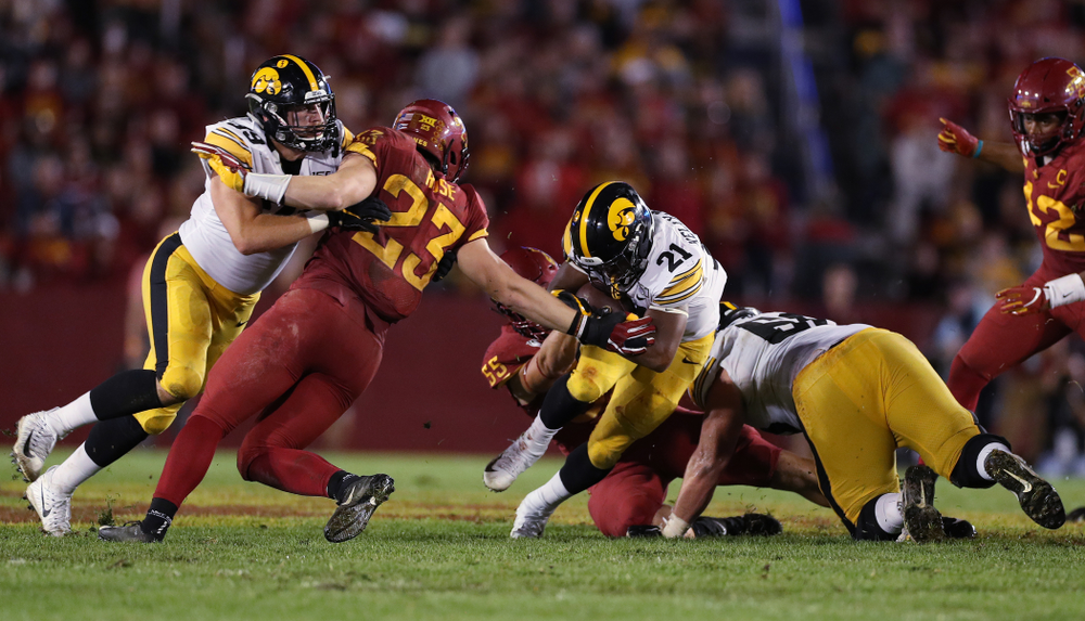 Iowa Hawkeyes running back Ivory Kelly-Martin (21) carries the ball against the Iowa State Cyclones Saturday, September 14, 2019 in Ames, Iowa. (Brian Ray/hawkeyesports.com)