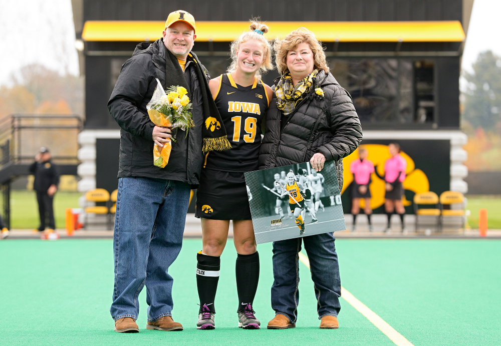Iowa's Ryley Miller (19) in honored with her parents on Senior Day before their game at Grant Field in Iowa City on Saturday, Oct 26, 2019. (Stephen Mally/hawkeyesports.com)