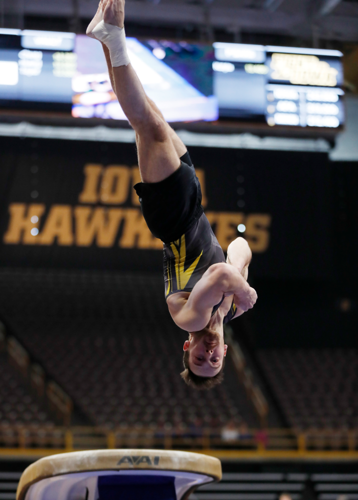 Dylan Ellsworth competes on the vault against Minnesota and Air Force