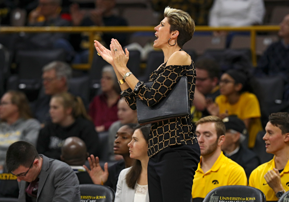 Iowa associate head coach Jan Jensen claps during the third quarter of their overtime win against Princeton at Carver-Hawkeye Arena in Iowa City on Wednesday, Nov 20, 2019. (Stephen Mally/hawkeyesports.com)