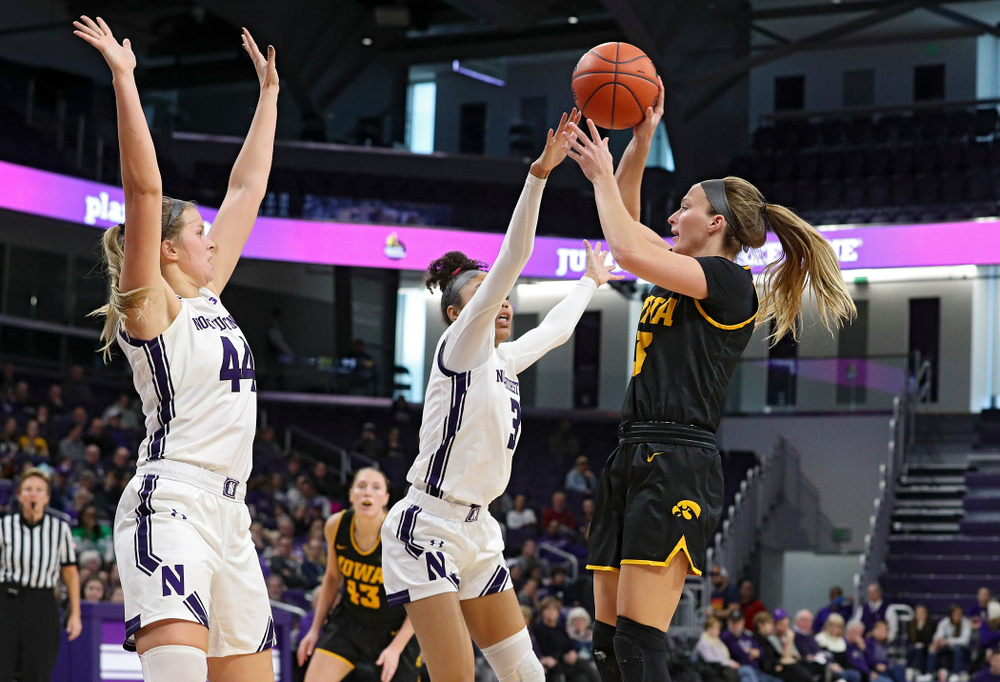 Iowa Hawkeyes guard Makenzie Meyer (3) passes the ball during the third quarter of their game at Welsh-Ryan Arena in Evanston, Ill. on Sunday, January 5, 2020. (Stephen Mally/hawkeyesports.com)
