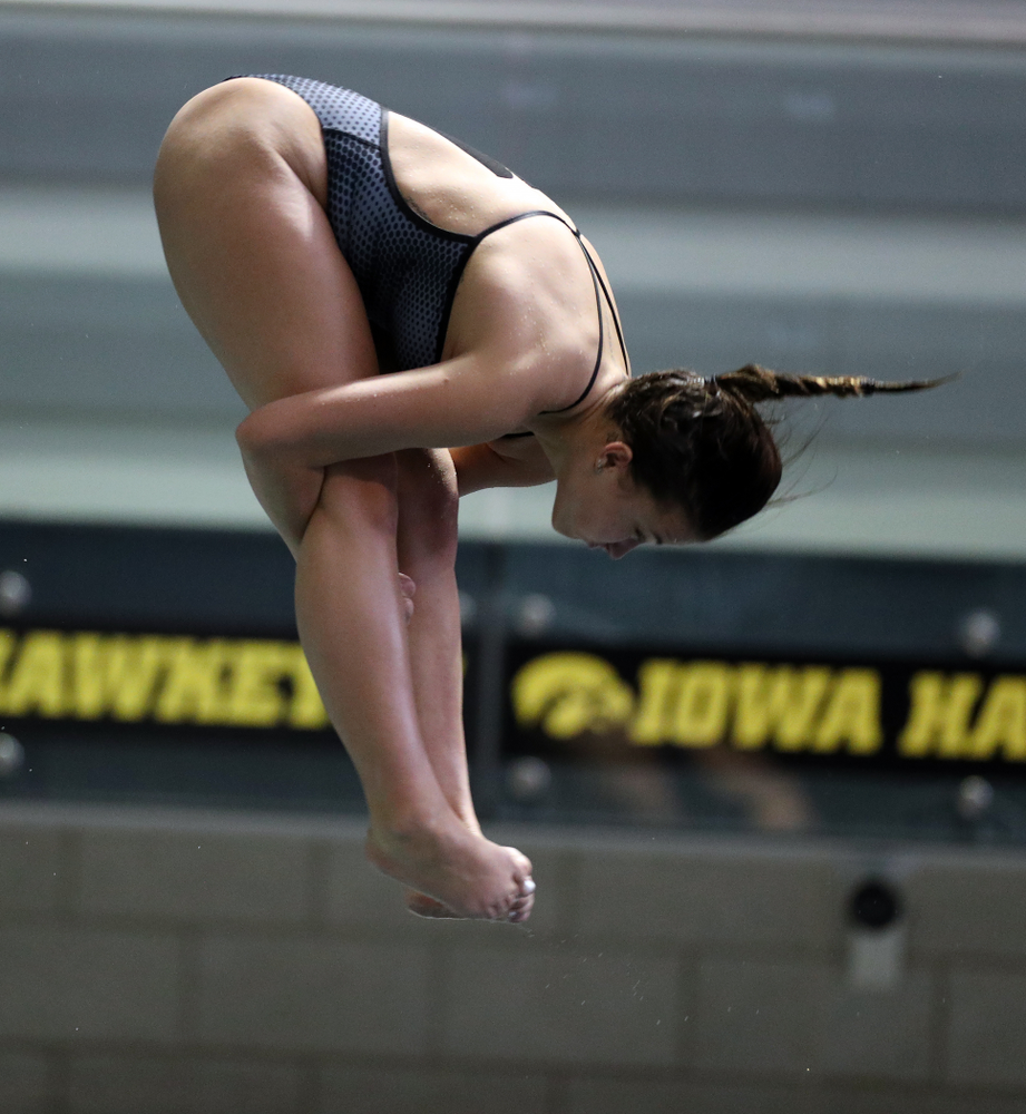 IowaÕs Jayah Mathews competes on the 1-meter springboard against the Michigan Wolverines Friday, November 1, 2019 at the Campus Recreation and Wellness Center. (Brian Ray/hawkeyesports.com)