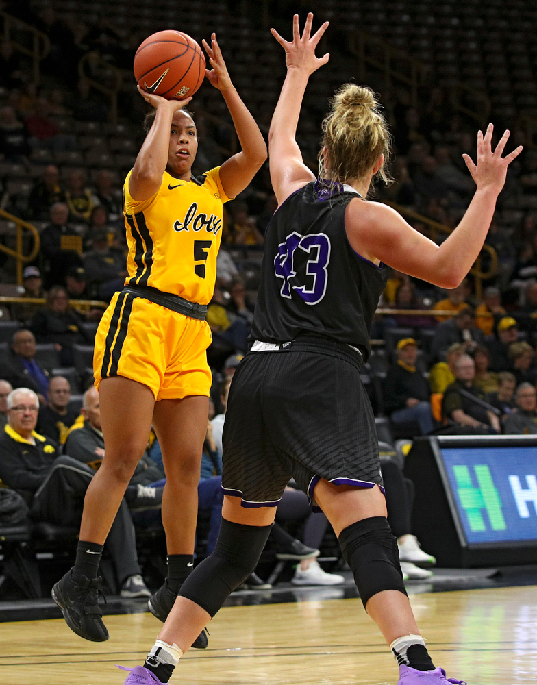 Iowa guard Alexis Sevillian (5) puts up a shot during the third quarter of their game against Winona State at Carver-Hawkeye Arena in Iowa City on Sunday, Nov 3, 2019. (Stephen Mally/hawkeyesports.com)