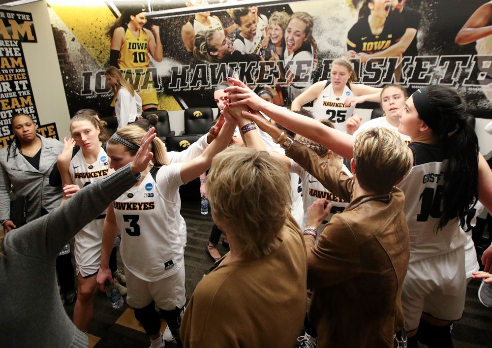 The Iowa Hawkeyes huddle after winning their game during the first round of the 2019 NCAA Women's Basketball Tournament at Carver Hawkeye Arena in Iowa City on Friday, Mar. 22, 2019. (Stephen Mally for hawkeyesports.com)