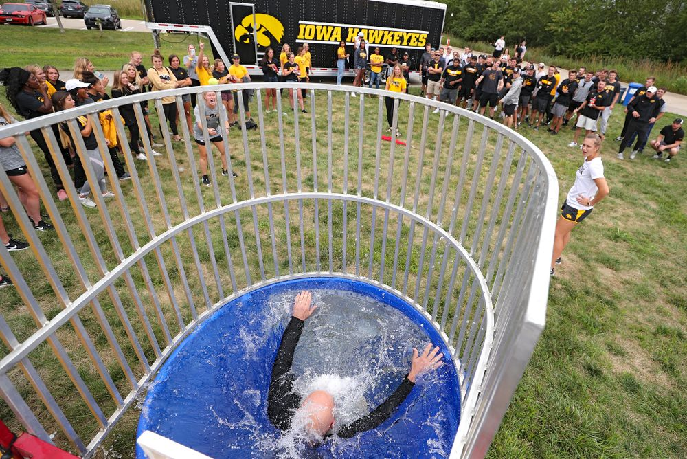 Iowa Baseball assistant coach Robin Lund drops into the water in the dunk tank during the Student-Athlete Kickoff outside the Karro Athletics Hall of Fame Building in Iowa City on Sunday, Aug 25, 2019. (Stephen Mally/hawkeyesports.com)