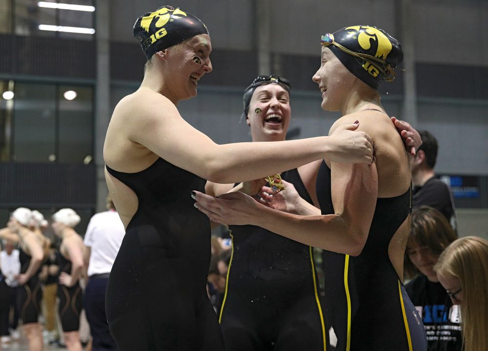 Iowa's Emilia Sansome, Aleksndra Olesiak, and Kelsey Drake celebrates after setting a school record in the women's 400 yard medley relay event during the 2020 Women's Big Ten Swimming and Diving Championships at the Campus Recreation and Wellness Center in Iowa City on Thursday, February 20, 2020. (Stephen Mally/hawkeyesports.com)