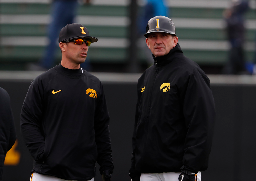 Iowa Hawkeyes pitching coach Desi Druschel and head coach Rick Heller during a double header against the Indiana Hoosiers Friday, March 23, 2018 at Duane Banks Field. (Brian Ray/hawkeyesports.com)