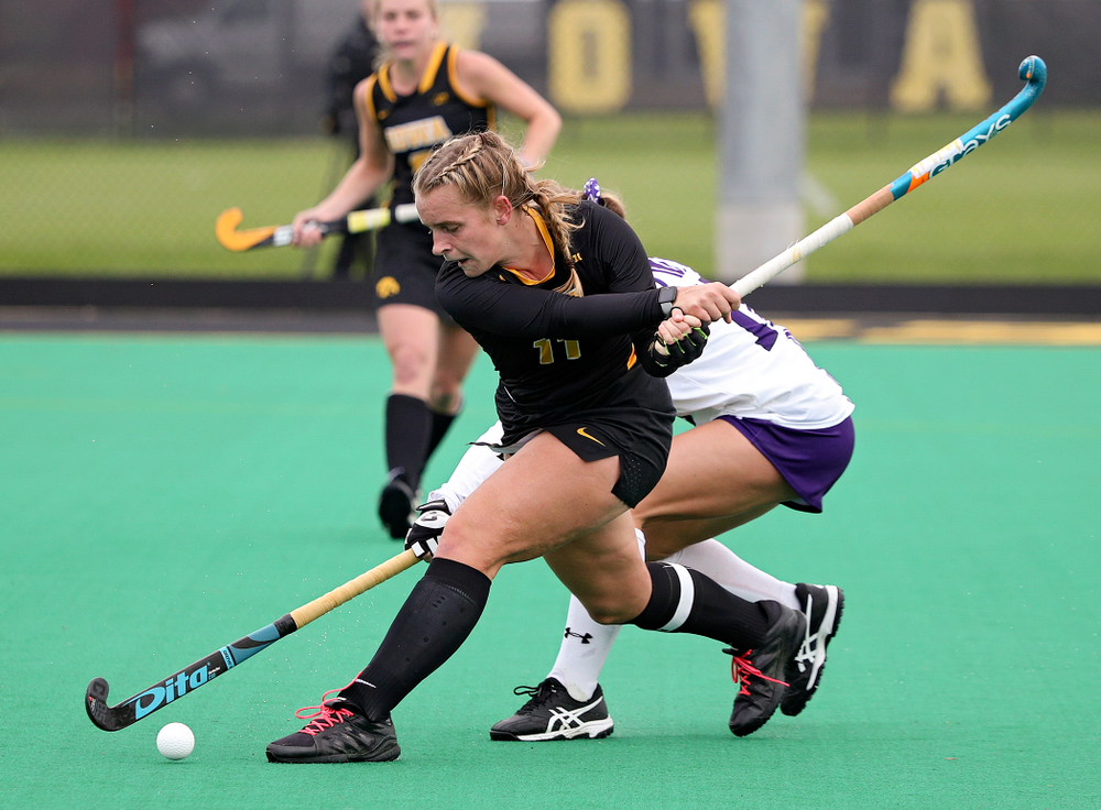 Iowa's Katie Birch (11) lines up a shot during the second quarter of their game at Grant Field in Iowa City on Saturday, Oct 26, 2019. (Stephen Mally/hawkeyesports.com)