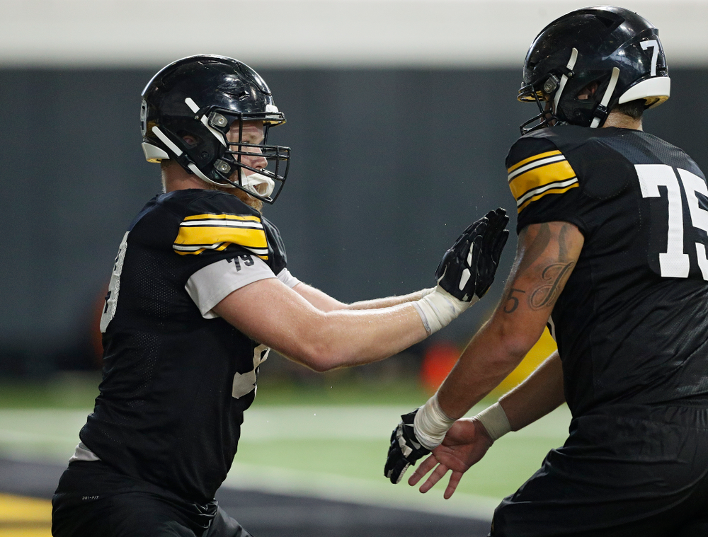 Iowa Hawkeyes offensive lineman Jack Plumb (79) works on a drill with offensive lineman Jeff Jenkins (75) during Fall Camp Practice No. 9 at the Hansen Football Performance Center in Iowa City on Monday, Aug 12, 2019. (Stephen Mally/hawkeyesports.com)