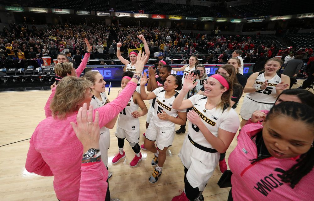 The Iowa Hawkeyes celebrate their victory over the Rutgers Scarlet Knights in the semi-finals of the Big Ten Tournament Saturday, March 9, 2019 at Bankers Life Fieldhouse in Indianapolis, Ind. (Brian Ray/hawkeyesports.com)
