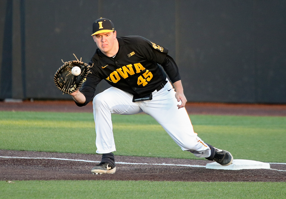 Iowa first baseman Peyton Williams (45) pulls in a throw during the fifth inning of their game at Duane Banks Field in Iowa City on Tuesday, March 3, 2020. (Stephen Mally/hawkeyesports.com)
