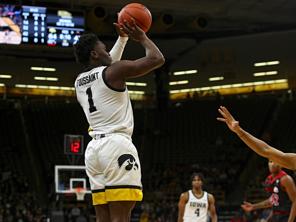 Iowa Hawkeyes guard Joe Toussaint (1) make a 3-pointer during the second half of their game at Carver-Hawkeye Arena in Iowa City on Friday, Nov 8, 2019. (Stephen Mally/hawkeyesports.com)