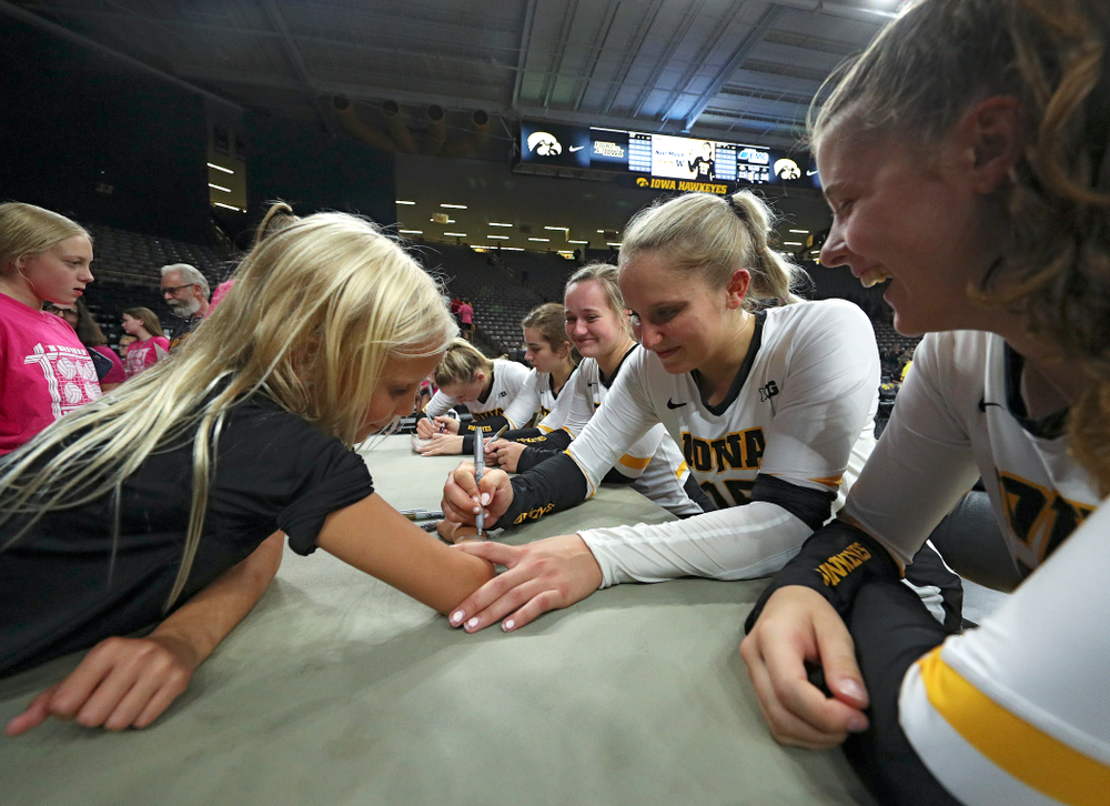 Iowa's Maddie Slagle (15) autographs a young fan's arm after their Big Ten/Pac-12 Challenge match against Colorado at Carver-Hawkeye Arena in Iowa City on Friday, Sep 6, 2019. (Stephen Mally/hawkeyesports.com)