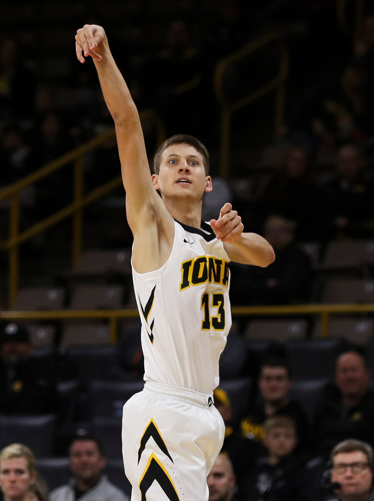 Iowa Hawkeyes guard Austin Ash (13) shoots a 3-pointer during a game against Guilford College at Carver-Hawkeye Arena on November 4, 2018. (Tork Mason/hawkeyesports.com)