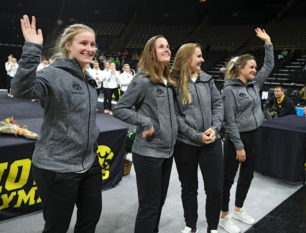 Iowa Field Hockey's Ryley Miller (from left), Sophie Sunderland, Katie Birch, and Maddy Murphy wave to the crowd at Carver-Hawkeye Arena in Iowa City on Sunday, March 8, 2020. (Stephen Mally/hawkeyesports.com)
