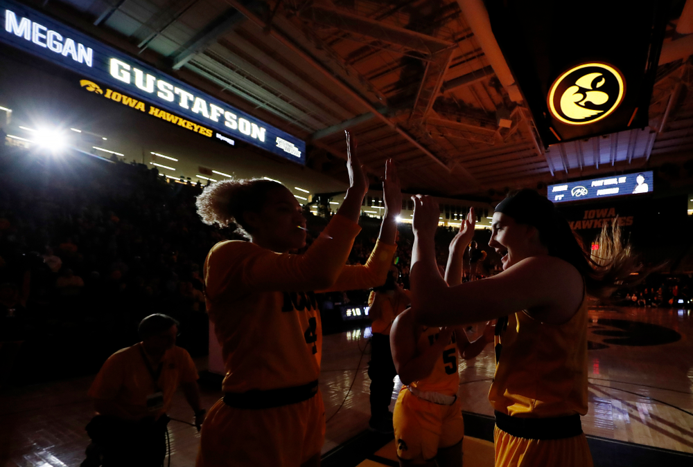 Iowa Hawkeyes forward Megan Gustafson (10) and forward Chase Coley (4)