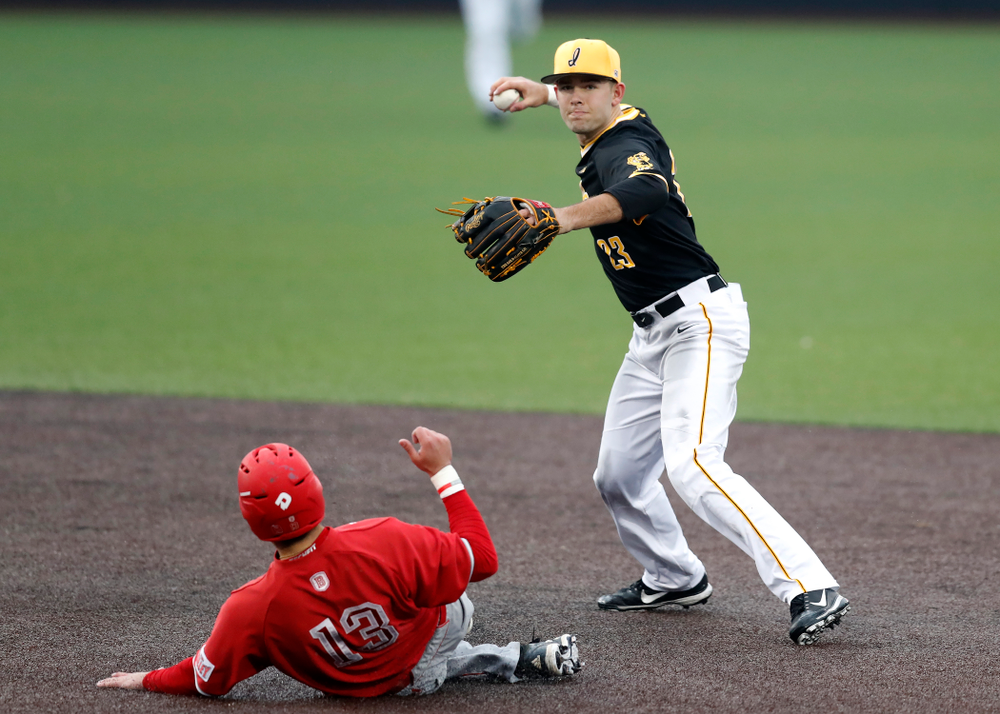 Iowa Hawkeyes infielder Kyle Crowl (23) turns a double play against the Bradley Braves Wednesday, March 28, 2018 at Duane Banks Field. (Brian Ray/hawkeyesports.com)