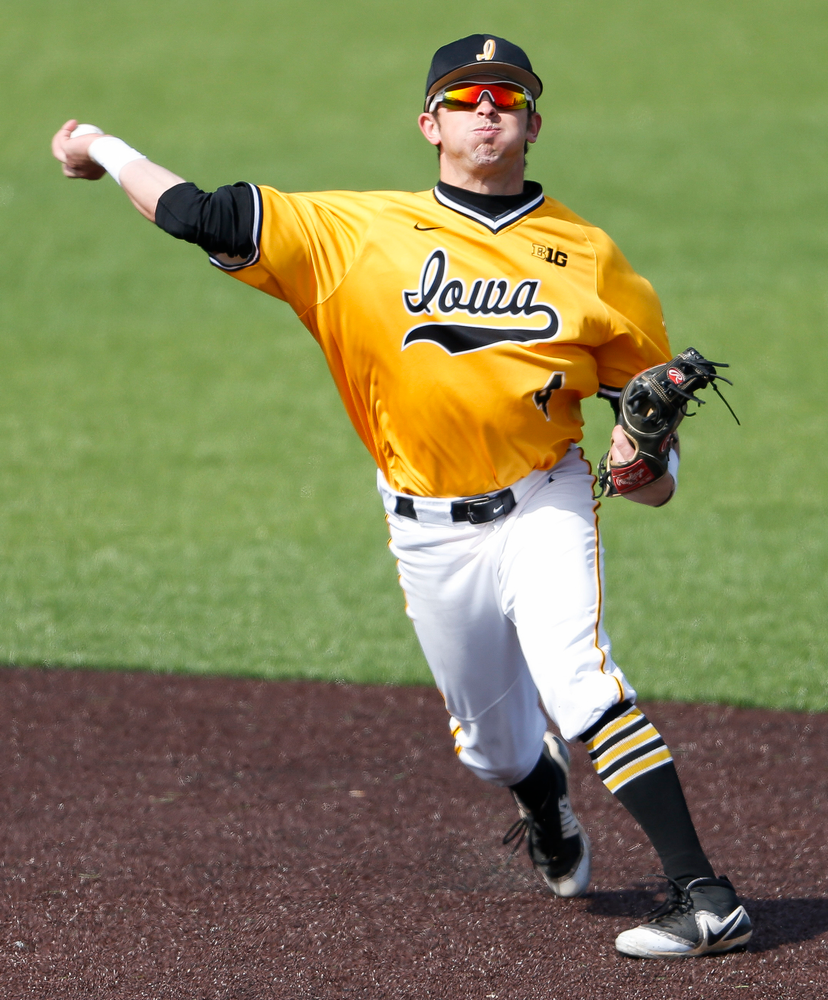 Iowa Hawkeyes infielder Mitchell Boe (4) throws to first base during a game against Evansville at Duane Banks Field on March 18, 2018. (Tork Mason/hawkeyesports.com)