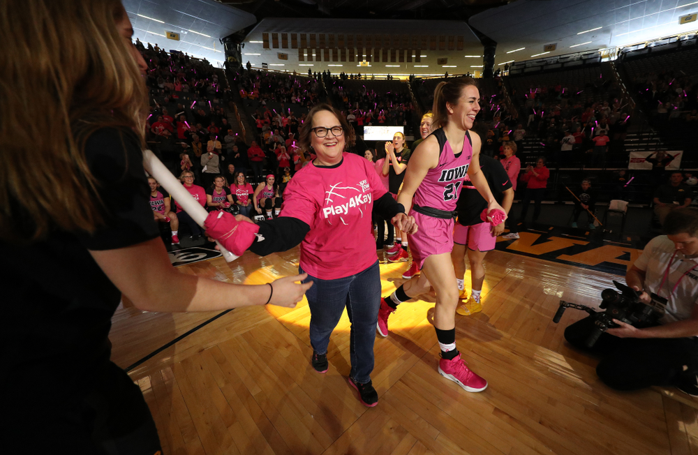 Iowa Hawkeyes forward Hannah Stewart (21) is introduced with a cancer survivor before their game against the seventh ranked Maryland Terrapins Sunday, February 17, 2019 at Carver-Hawkeye Arena. (Brian Ray/hawkeyesports.com)