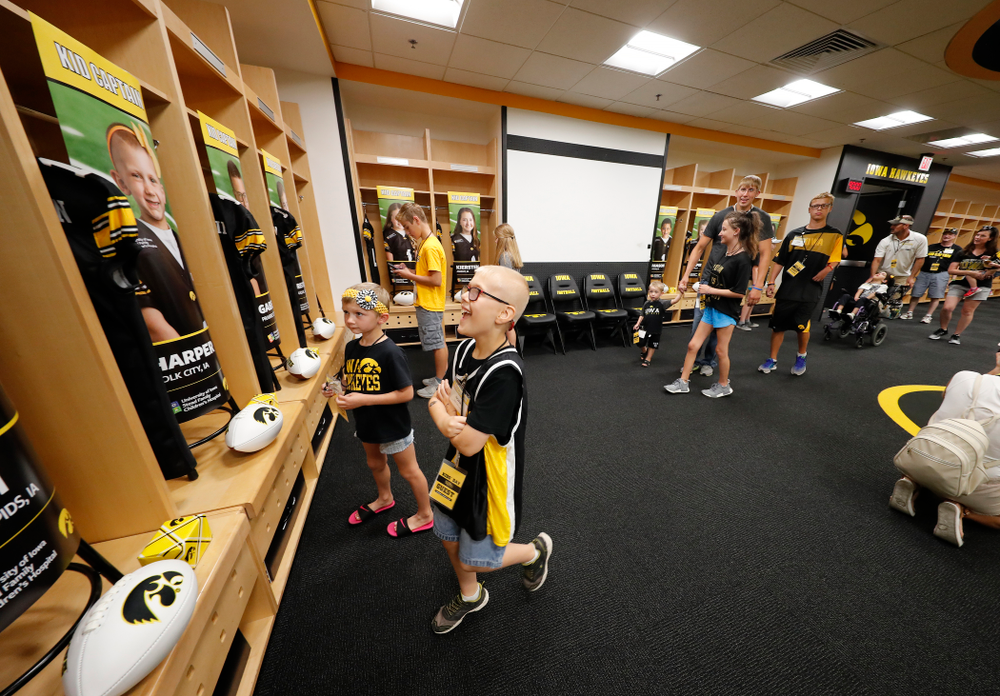 The Kid Captains check out their lockers during Kids Day Saturday, August 11, 2018 at Kinnick Stadium. (Brian Ray/hawkeyesports.com)
