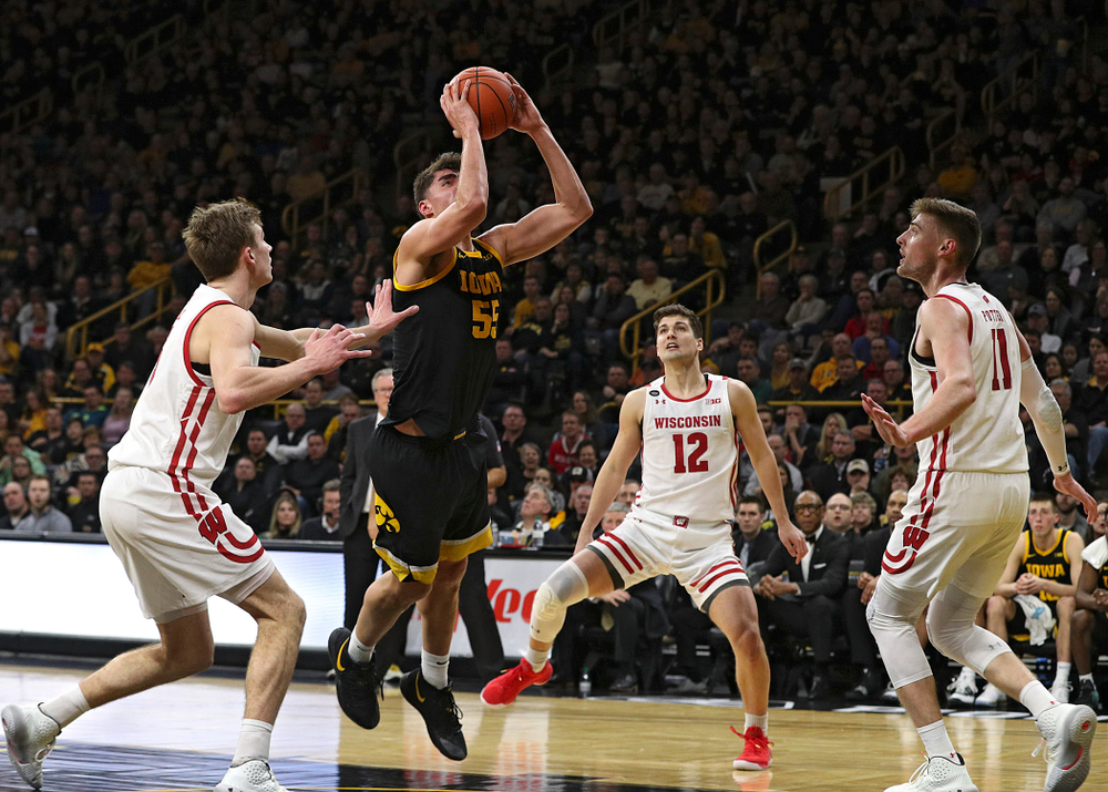 Iowa Hawkeyes center Luka Garza (55) scores a basket inside during the second half of their game at Carver-Hawkeye Arena in Iowa City on Monday, January 27, 2020. (Stephen Mally/hawkeyesports.com)