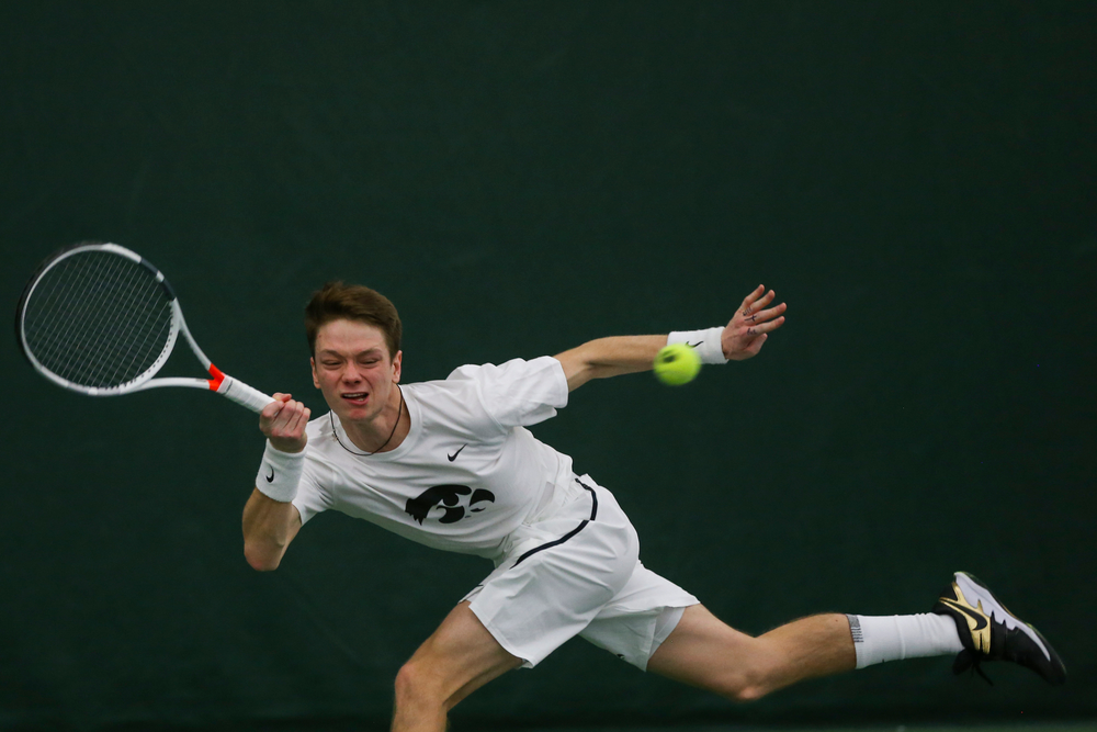 Iowa's Jason Kerst dives for a ball during the Iowa men's tennis match vs Western Michigan on Saturday, January 18, 2020 at the Hawkeye Tennis and Recreation Complex. (Lily Smith/hawkeyesports.com)