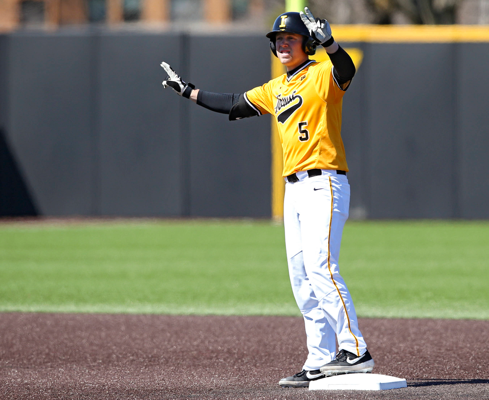 Iowa Hawkeyes first baseman Zeb Adreon (5) holds up two fingers after hitting a double during the fourth inning against Illinois at Duane Banks Field in Iowa City on Sunday, Mar. 31, 2019. (Stephen Mally/hawkeyesports.com)