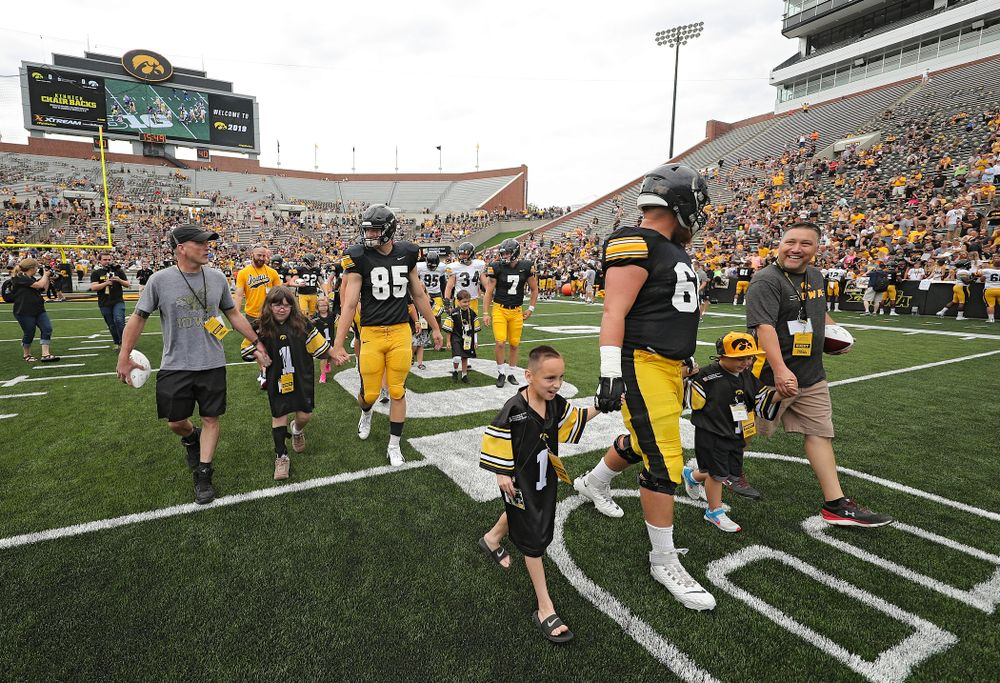 The Kid Captains swarm with Iowa players during Kids Day at Kinnick Stadium in Iowa City on Saturday, Aug 10, 2019. (Stephen Mally/hawkeyesports.com)