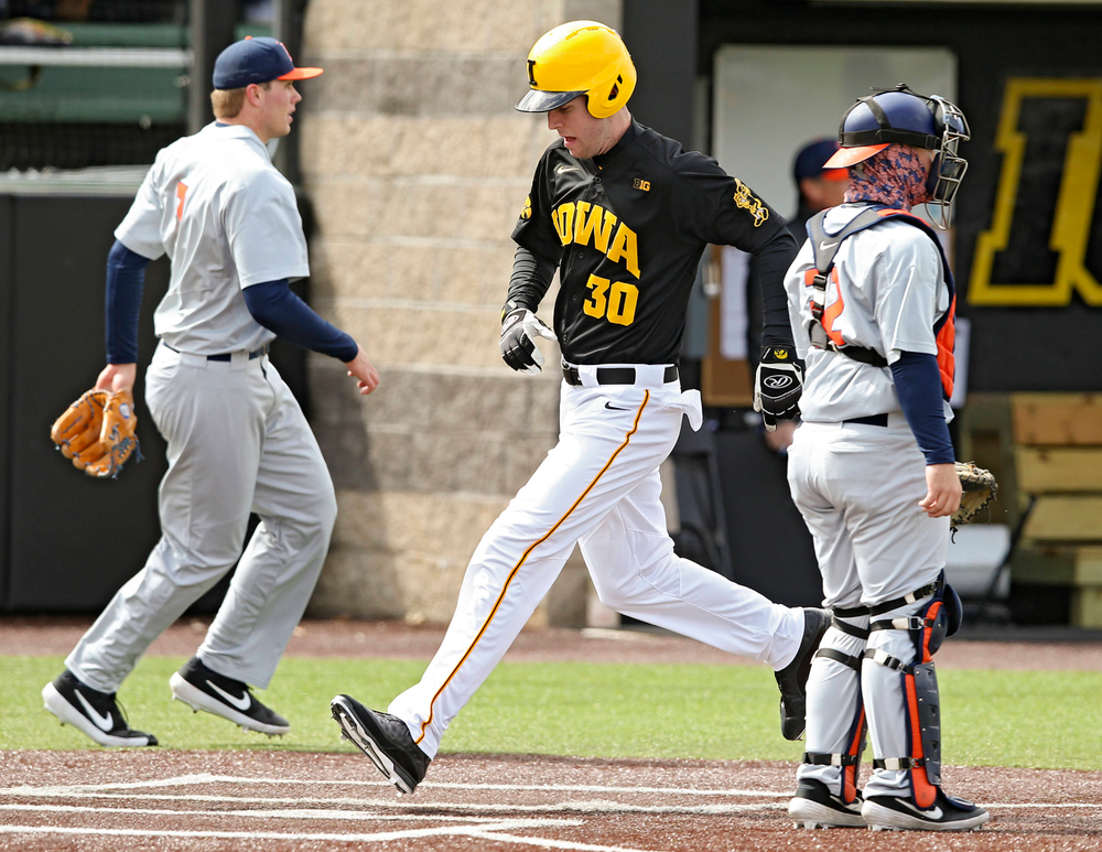 Iowa Hawkeyes left fielder Connor McCaffery (30) scores a run during the second inning of their game against Illinois at Duane Banks Field in Iowa City on Saturday, Mar. 30, 2019. (Stephen Mally/hawkeyesports.com)