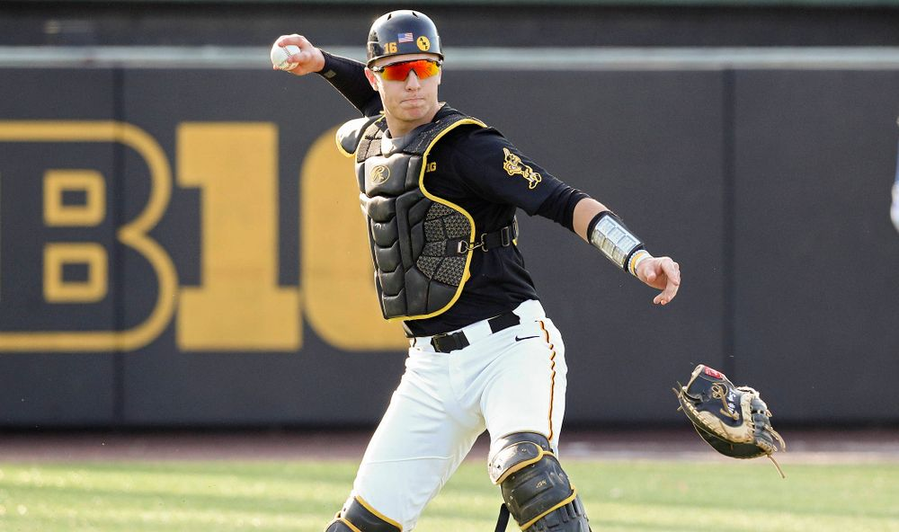 Iowa catcher Tyler Snep (16) throws to first base for an out during the third inning of their college baseball game at Duane Banks Field in Iowa City on Tuesday, March 10, 2020. (Stephen Mally/hawkeyesports.com)