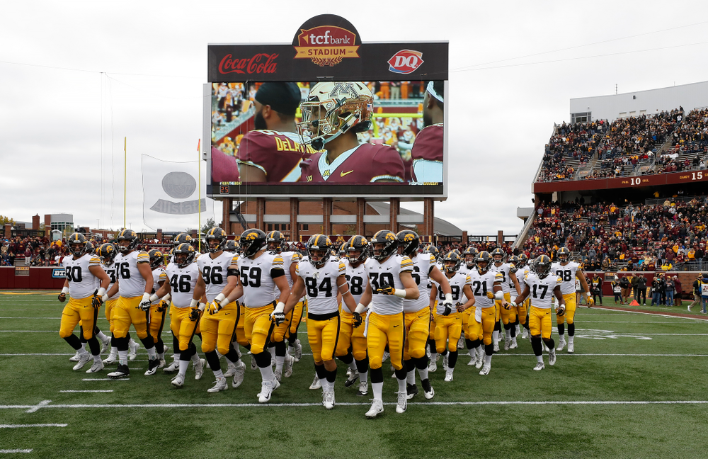 The Iowa Hawkeyes swarm out for their game against the Minnesota Golden Gophers Saturday, October 6, 2018 at TCF Bank Stadium. (Brian Ray/hawkeyesports.com)