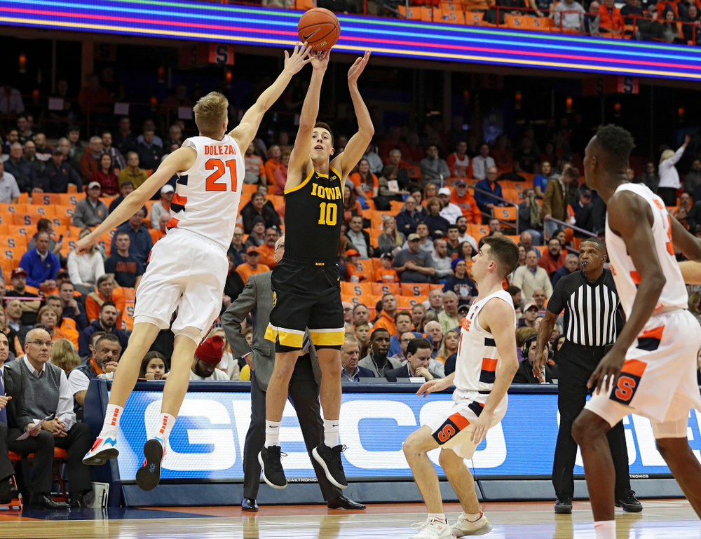 Iowa Hawkeyes guard Joe Wieskamp (10) makes a 3-pointer during the first half of their ACC/Big Ten Challenge game at the Carrier Dome in Syracuse, N.Y. on Tuesday, Dec 3, 2019. (Stephen Mally/hawkeyesports.com)