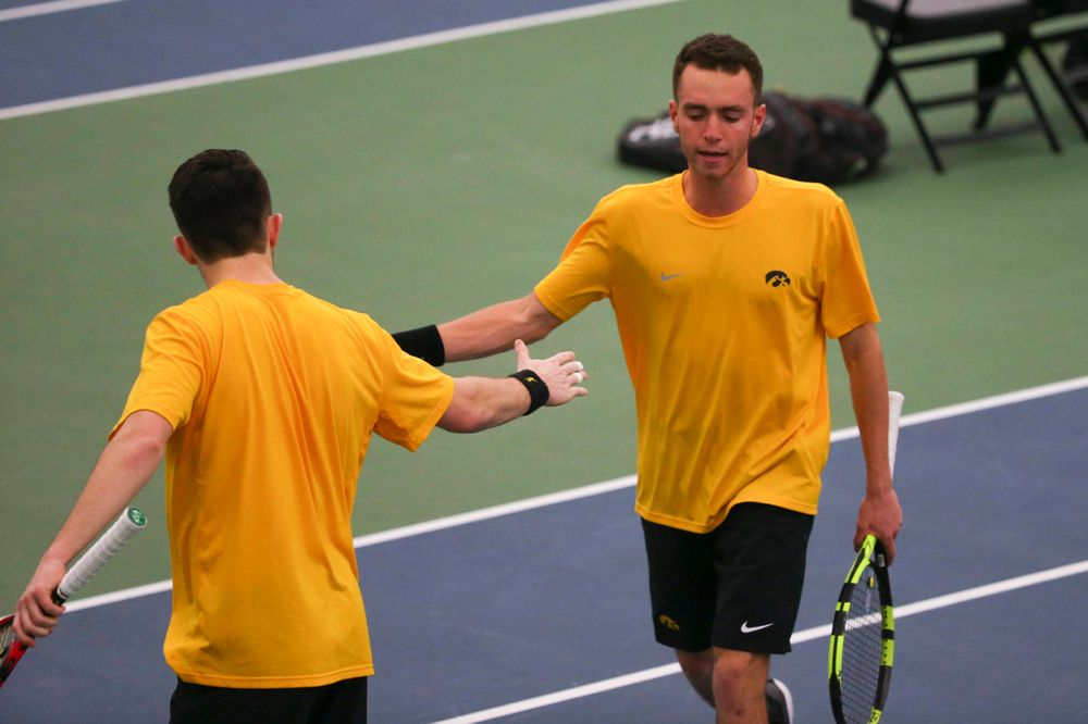 Iowa's Kareem Allaf (right) and Jonas Larsen (left) at a tennis match vs Drake  Friday, March 8, 2019 at the Hawkeye Tennis and Recreation Complex. (Lily Smith/hawkeyesports.com)