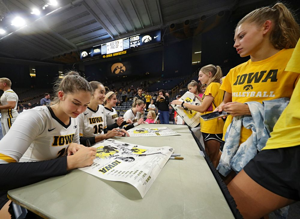 Iowa's Blythe Rients (11), Grace Tubbs (16), Maddie Slagle (15), and Jaedynn Evans (22) sign autographs after their Big Ten/Pac-12 Challenge match against Colorado at Carver-Hawkeye Arena in Iowa City on Friday, Sep 6, 2019. (Stephen Mally/hawkeyesports.com)