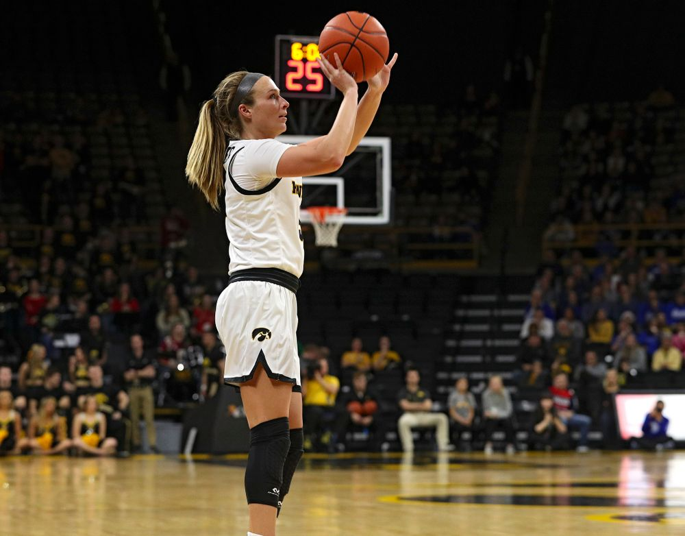 Iowa Hawkeyes guard Makenzie Meyer (3) makes a 3-pointer during the third quarter of their game at Carver-Hawkeye Arena in Iowa City on Saturday, December 21, 2019. (Stephen Mally/hawkeyesports.com)